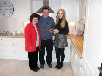 Mr and Mrs Donkin receive their Linx 7 abler from Peter Ward Homes' creative partners, Communique Advertising.